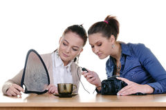 Girls photographing an empty cup Stock Photos