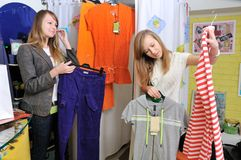 Girls pick out clothes to buy Royalty Free Stock Photo