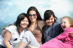 Girls on pier Stock Photography