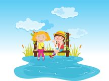 Girls on pier. Two girls sitting on a pier near the water Royalty Free Stock Images