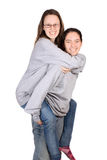 Girls piggy bag play Royalty Free Stock Photography