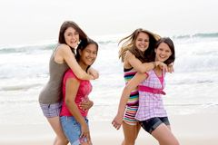 Girls piggyback Royalty Free Stock Photo