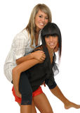 Girls piggyback Stock Images