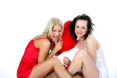 GIRLS PILLOW FIGHTING Stock Photos