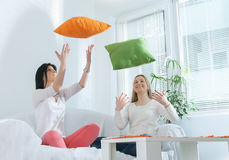 Girls with pillows Royalty Free Stock Photo