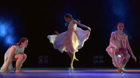 Girls in pink air dresses dancing on stage Royalty Free Stock Images