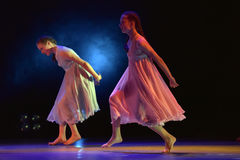 Girls in pink air dresses dancing on stage Royalty Free Stock Photography