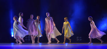 Girls in pink air dresses dancing on stage Royalty Free Stock Image