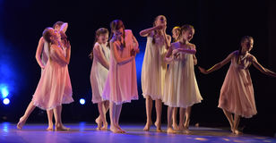 Girls in pink air dresses dancing on stage Stock Photography