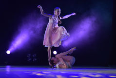Girls in pink air dresses dancing on stage Stock Photos