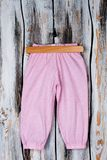 Girls` pink pants on hanger Royalty Free Stock Images