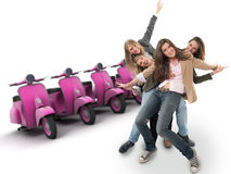 Girls and pink scooters. A group of happy girls and a line of scooters Royalty Free Stock Photo