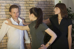 Girls pinned man to the wall Royalty Free Stock Images