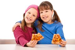 Girls with pizza Stock Images