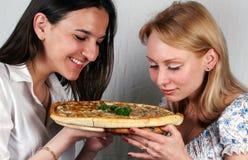 Girls & pizza italian Royalty Free Stock Photos