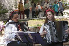 Girls play the accordion Royalty Free Stock Photo