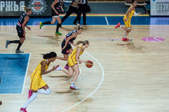 Girls play basketball. Royalty Free Stock Photos