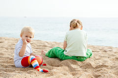 Girls play on the beach Royalty Free Stock Photography