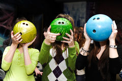 Girls play bowling. By color spheres Stock Photo