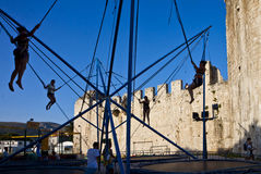 Girls play bungee jumping in Trogir Stock Photography