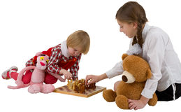 Girls play chess Royalty Free Stock Images