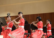 Girls play flutes carefully Royalty Free Stock Images