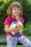 Girls play football. Little, cute girl with colorful football outdoors Stock Photo