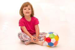Girls play football!. Little, cute girl with colorful football isolated on white Stock Photos