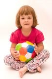 Girls play football!. Little, cute girl with colorful football isolated on white Royalty Free Stock Photography