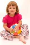 Girls play football!. Little, cute girl with colorful football isolated on white Royalty Free Stock Image