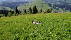 Girls play at green meadow. Two young girls play at green meadow in Carpathian mountains stock video