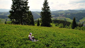 Girls play at green meadow. Two young girls play at green meadow in Carpathian mountains stock video footage