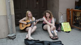 Girls play guitar sing Stock Image