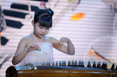 Girls play the Guzheng Stock Images