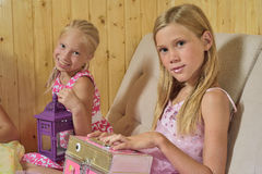 Girls play house Stock Images