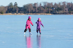 Girls play on ice Royalty Free Stock Photo