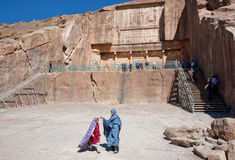 Girls play next to the historical tomb of persian king Royalty Free Stock Images