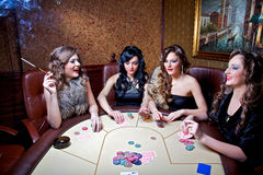 Girls play poker Stock Photography