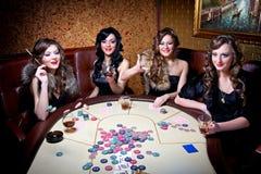 Girls play poker royalty free stock photo