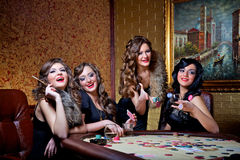 Girls play poker Stock Photos
