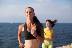 Girls play sports running around on the Beach. Girls play sports running around on the Ocean Beach Stock Photos
