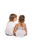 Girls play, talk in your ear, talk, children's secrets, white ba Royalty Free Stock Photography