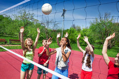 Girls play together volleyball on the playground stock photos