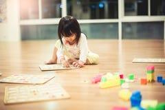 Girls play toys royalty free stock photos