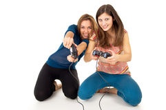 Girls play video games on the joystick Stock Images