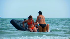 Girls play water sun beach happy vacation stock footage