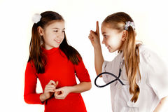 Girls played be a doctor Royalty Free Stock Image