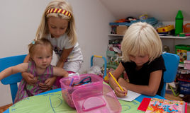 Girls playing. Tree sisters are having fun in their room Stock Photography