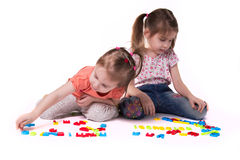 Girls playing with alphabet stock photo