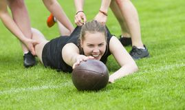 Girls playing american football together outside in summer royalty free stock photos